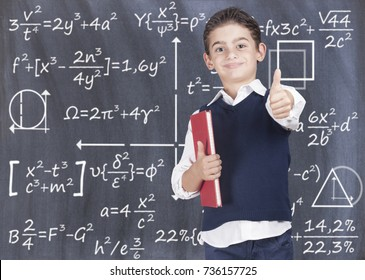 Education concept with smart school boy in front of a blackboard