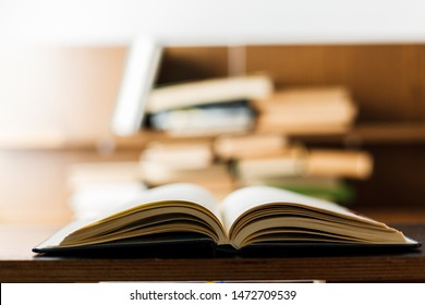 Education concept. Stack of books on table. Blur bookshelf background