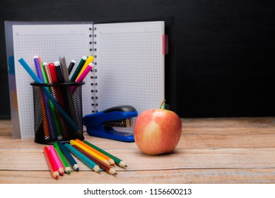 Education concept. Stationery for school pupil mockup with glasses and notebook on blue background top view copy space