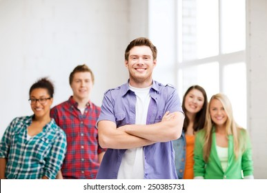 education concept - student boy with group of students at school
