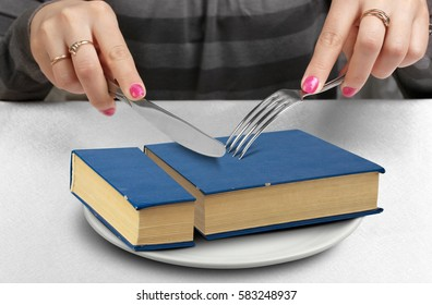 education creative concept, cut book on plate