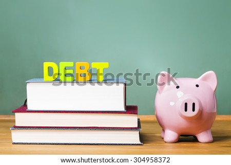 Education debt them with textbooks, piggy bank and chalkboard background