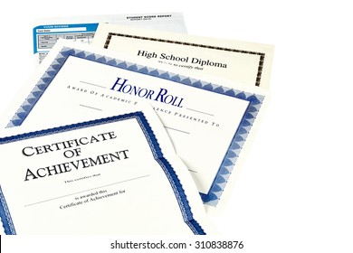 Education documents including SAT report, high school diploma, honor roll recognition, commencement program and certificate of achievement isolated on black