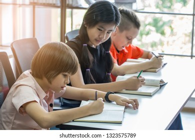 Education doing homework and exam concept. A group of children studying and  taking examinations in schools and friends to copy homework during exams.
