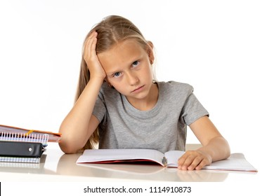 education, elementary school, childhood and emotions concept sad or bored little student girl studying looking frustrated with learning problems on white background