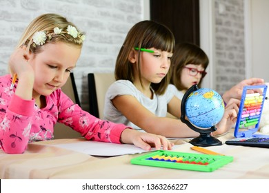 Education, elementary school, learning, children and people concept. Group of school kids with pens and papers writing in the room.