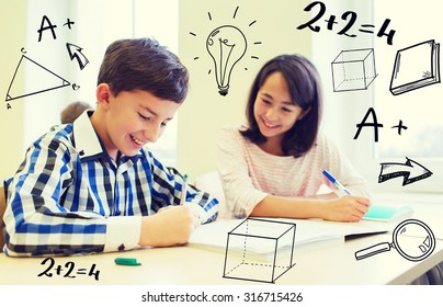education, elementary school, learning and people concept - group of school kids with pens and notebooks writing test in classroom with doodles