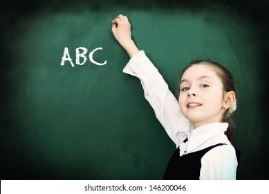 Education. Elementary school student at the blackboard. School concept