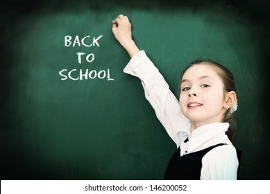 Education. Elementary school student at the blackboard. School concept - Back to School