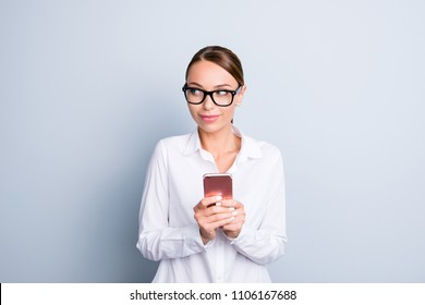 Education employee secretary concept. Portrait of smart clever beautiful attractive charming woman wearing white classic blouse using holding modern smartphone in hands isolated on gray background