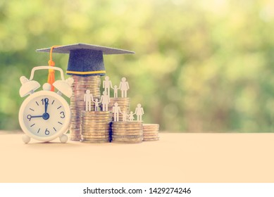 Education fund, academic scholarship concept : Black graduation cap, a clock, student and family on rows of rising coins, depicts loans for student to lend for university / college or learning expense