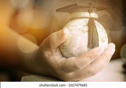 Education in Global, Graduation cap on Businessman holding Earth globe model map with Radar background in hands. Concept of global business, abroad educational, Back to School.
