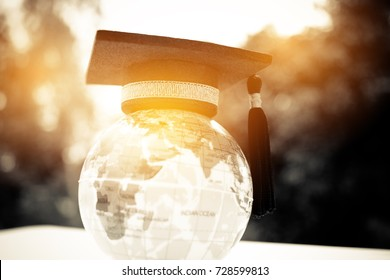 Education in Global, Graduation cap on top model Earth. Concept of abroad international Educational, Back to School and Studies lead to success in world wide to learning anywhere anytime.