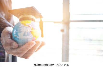 Education in Global, Graduation cap on Businessman holding Earth globe model map with Radar background in hands. Concept of global business, abroad international educational, Back to School.