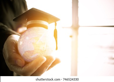 Education in Global, Graduation cap on Businessman holding Earth globe model map with Radar background in hands. Concept of world business, abroad  international educational, Back to School.