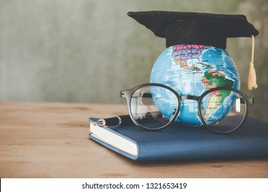 Education in Global world, Graduation cap with Earth globe model map and glasses on book . Concept of global business study, abroad educational, Back to School.