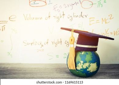 Education Graduate mortarboard blue hat on textbook with formula equation Mathematics on screen near global model, Ideas for learning success in study abroad international university, Back to School
