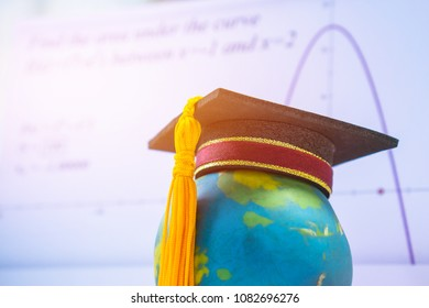 Education Graduate study international concept: Graduation cap on top Earth globe model map with formula equation graph on screen classroom. Ideas for knowledge learning success, Back to School