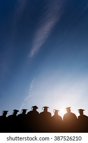 Education Graduation with blue sky vertical with sun flare