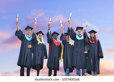 education, graduation and people concept - group of happy intern