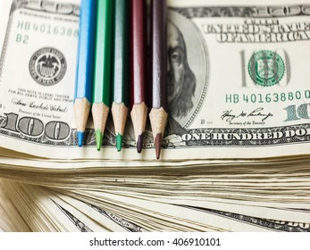 education has a price, the money allocated for education, investment in knowledge, dollars and pencils, scholarship, very soft focus - Shutterstock ID 406910101