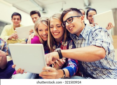 education, high school, technology and people concept - group of smiling students with tablet pc computers taking photo or video indoors