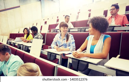 education, high school, university, learning and people concept - group of international students talking on lecture