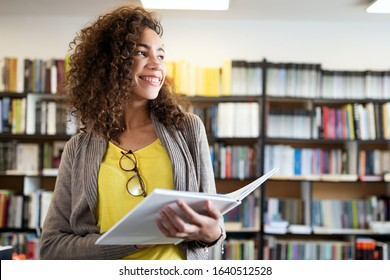Education, high school, university, learning and people concept. Smiling student girl reading book