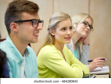 education, high school, university, learning and people concept - group of students at lecture