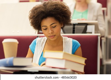 education, high school, university, learning and people concept - african student girl with books and coffee on lecture