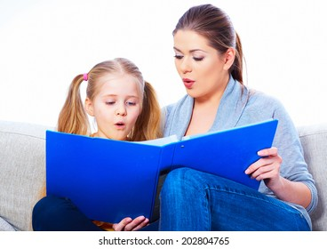 Education at home with parents. Reading book.