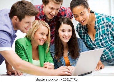 education and internet - smiling students looking at tablet pc in lecture at school