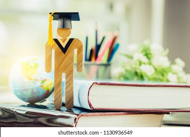 Education knowledge learning study abroad international Ideas. People Sign wood with Graduation celebrating cap on open textbook, America global map show alternative studying Back to School Concept