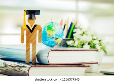 Education knowledge learning study abroad international Ideas. Student Sign wood with Graduation celebrating cap open textbook, America global map show alternative studying Back to School Concept