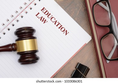 Education Law with gavel and red book