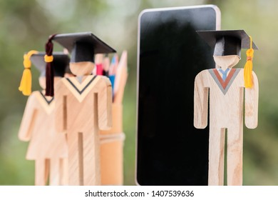 education learning concept, university knowledge achievement for study abroad international, alternative studying idea. Models graduation celebration with smartphone pencils box, copy space for text