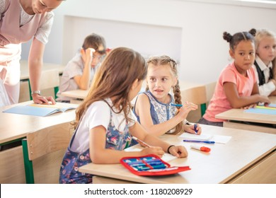 education, learning, homework concept - schoolchild girl writing school test