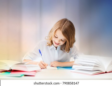 education, people, children and school concept - little student girl sitting at table with books and writing in notebook over rose quartz and serenity gradient background