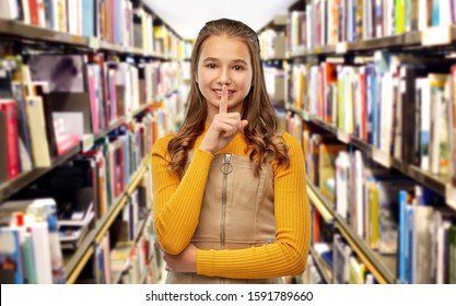 education, reading and silence concept - young teenage student girl making hush gesture over library background