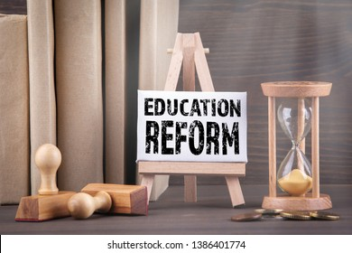 Education reform concept. Sandglass, hourglass or egg timer on wooden table showing the last second or last minute or time out