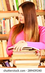 Education school concept. Intelligent female student fashion long hair girl in college library with pen