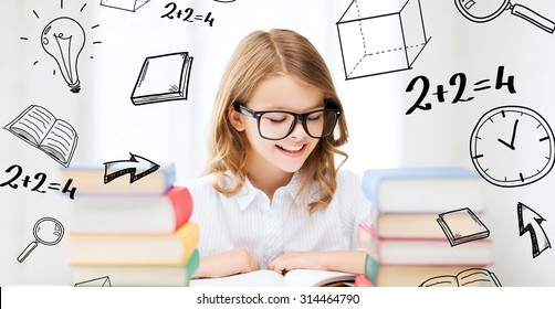 education and school concept - little student girl studying and reading books at school