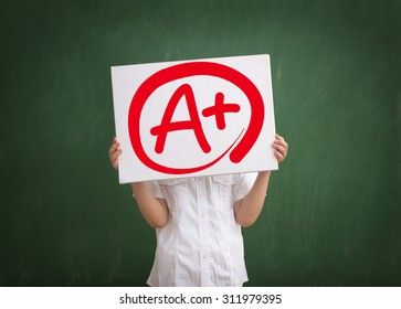 education and school concept  of A plus grade, elementary school student showing