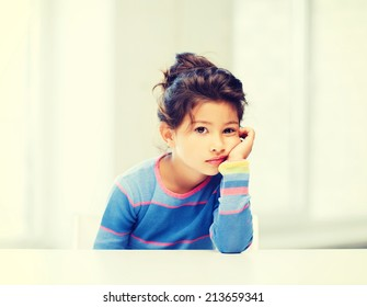 education and school concept - tired little student girl at school