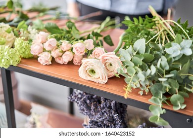 Education in the school of floristry. Master class on making bouquets. Summer bouquet. Learning flower arranging, making beautiful bouquets with your own hands. Flowers delivery