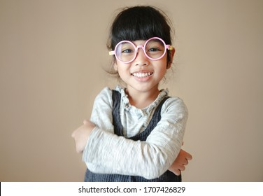 education, school and vision concept - smiling cute little child girl with eyeglasses.