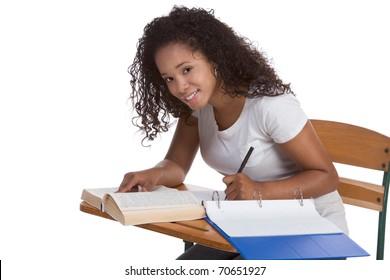 education series - ethnic black woman high school student sitting by school desk doing homework