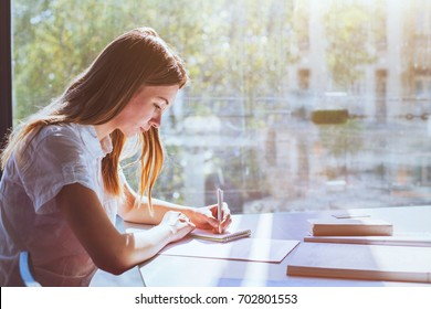 education, student girl in university during exam, young woman studying, people writing test
