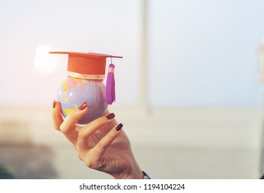 Education study abroad in Global world,Back to School and Graduation cap on student hand holding Earth globe map,Success of Global business study abroad educational,congratulation Graduation Ceremony