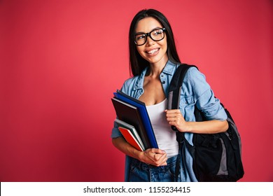 Education, study, graduate, university, college, high school, student, knowledge concepts. Portrait of young beautiful cute smart student girl with many stuff for lessons in hands and backpack